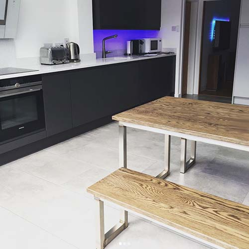 ebony brushed stainless steel dining table and benches