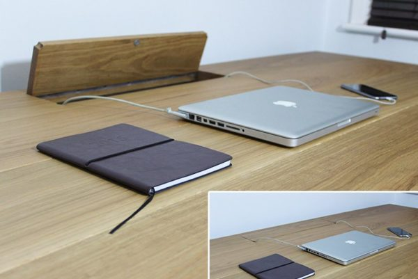 industrial desk that stores cables away